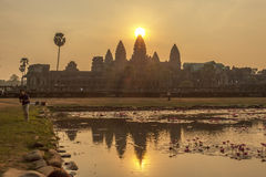 Angkor Wat at sunset, Siem Reap, Cambodia. The lake in front of the Angkor Wat where tourists commonly stand here to take picture of Angkor Wat at sunset when stock photo