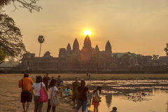 Angkor Wat at sunset, Siem Reap, Cambodia. The lake in front of the Angkor Wat where tourists commonly stand here to take picture of Angkor Wat at sunset when stock photography