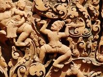 Angkor Wat - tallas hermosas, alivios de bas del templo de Banteay Srei imagen de archivo