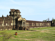 Angkor Wat temple. Ancient building, green grass and beautiful blue sky of a long bacony of Angkor Wat temple. Angkor Wat is a world heritage of Siem Reap royalty free stock photography