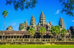 Angkor Wat temple with palms and lake,  Cambodia Stock Photos