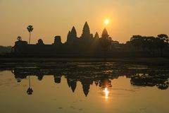 Angkor Wat Temple reflected on the lake at sunrise. In Siemp Reap, Cambodia. Unesco World Heritage Site. Ancient landmark, travel destination, tourism concept royalty free stock photo