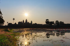 Angkor Wat temple silhouette in the morning at the sunrise. Reflection in the lake. World Largest Religious Monument Royalty Free Stock Image