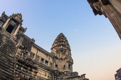 Angkor Wat Temple at sunrise with the Moon on the blue sky. Beautiful unusual view. Stairs leading to upper gallery and. Stairs leading to upper galleries and Royalty Free Stock Image