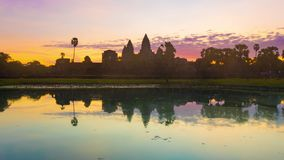 Angkor Wat temple at sunrise. Siem Reap. Cambodia. Timelapse. Angkor Wat temple reflecting in water of Lotus pond at sunrise. Siem Reap. Cambodia. Timelapse stock video