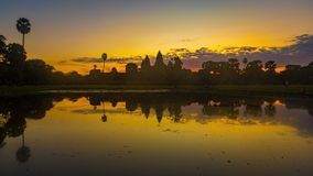 Angkor Wat temple at sunrise. Siem Reap. Cambodia. Timelapse. Angkor Wat temple reflecting in water of Lotus pond at sunrise. Siem Reap. Cambodia. Timelapse stock footage
