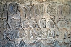 Angkor Wat 12th century bas relief, Yama Judgment, depiction of heaven. Scene around the Angkor Archaeological Park. The site contains the remains of the Royalty Free Stock Photo
