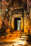 Angkor Wat - UNESCO World Heritage site near Siem Reap, Cambodia. Interior of an ancient Cambodian temple Angkor Wat in the rays of sunrise  - UNESCO World Royalty Free Stock Photo