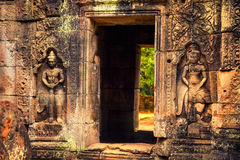 Angkor Wat - UNESCO World Heritage site near Siem Reap, Cambodia. Interior of an ancient Cambodian temple Angkor Wat in the rays of sunrise  - UNESCO World Royalty Free Stock Image