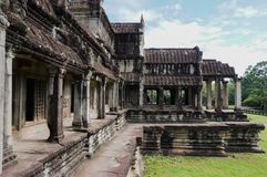 Angkor Wat is an UNESCO World Herutage site since 1992.An Asian woman opens her hands to embrace this beautiful landscape. Angkor Wat is an UNESCO World Stock Image