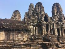 Angkor Wat w Siem Przeprowadza żniwa, cambodia Kamień twarze rzeźbili w antycznych ruinach Bayon Khmer świątynia obraz royalty free
