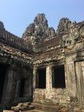 Angkor Wat w Siem Przeprowadza żniwa, cambodia Kamień twarze rzeźbili w antycznych ruinach Bayon Khmer świątynia fotografia royalty free