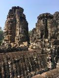 Angkor Wat w Siem Przeprowadza żniwa, cambodia Kamień twarze rzeźbili w antycznych ruinach Bayon Khmer świątynia zdjęcie stock