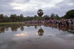 Angkor Wat the World Heritage Seven Wonders of the Word, Siem Reap, Cambodia. Tourist standing and waiting for Sunrise view of ancient temple complex at entrance royalty free stock photography