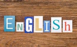 ` Anglais de ` de Word sur le fond en bois Photo stock