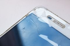 Angle of broken mobile phone display close up. Copy space stock images