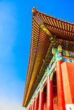 The angle of the Chinese temple view from the bottom of the roof bright colored in a sunny autumn day Royalty Free Stock Images