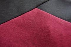 Angle des rubans noirs sur le tissu marron Image stock