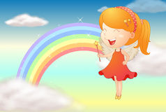 An angle girl and a rainbow Stock Photos