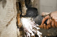Angle grinder. Reconstruction of home concept , plumbing concept Stock Images