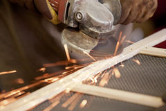 Angle grinder. Grinding the head of screws making sparks Royalty Free Stock Images