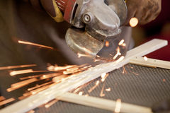 Angle grinder. Grinding the head of screws making sparks Stock Photography