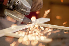 Angle grinder. Grinding the head of screws making sparks Stock Photos