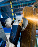 Angle grinder. Cutting steel with sparks Royalty Free Stock Photography