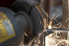 Angle Grinder in action. Angle grinder power tool showering sparks royalty free stock photo