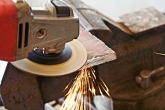 Angle grinder buffing steel plate. Sparks fly from and angle grinder Royalty Free Stock Photos