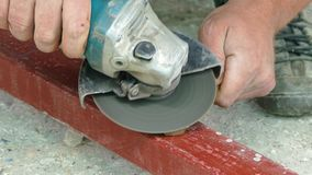 Angle grinder clears the wrench. Angle grinder cleans the wrench from rust stock video