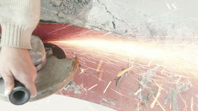 Angle grinder cut metal. Electric saw to cut a piece of the metal strip stock footage