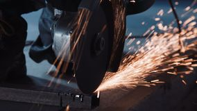 Working angle grinder. Angle grinder cutting through metal and producing a lot of sparks stock video footage