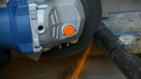 Angle grinder slow motion. Angle grinder Cutting metal slow motion, close to stock video footage