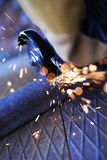 Angle grinder cutting steel, construction site Royalty Free Stock Image