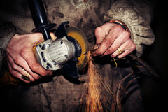 Angle grinder in hand Royalty Free Stock Images