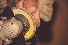 Angle grinder in hand Royalty Free Stock Photos