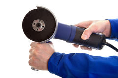 Angle grinder in hands Royalty Free Stock Photo