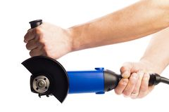 Angle grinder  in mans hansds isolated on a white background stock images