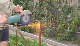 Angle Grinder Metal sawing with flashing sparks close up Stock Photo