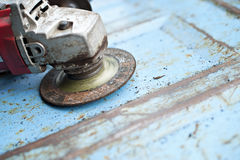 Angle Grinder on Old Truck Tailgate Royalty Free Stock Photo