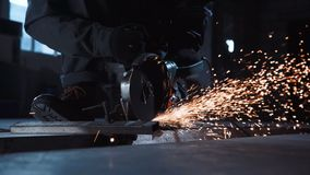 Angle grinder and sparks closeup stock video
