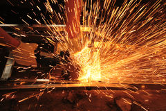 Angle grinder and sparks. The worker with angle grinder cuts metal, creates many sparks stock photos