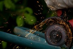 Angle Grinder with Sparks Royalty Free Stock Images