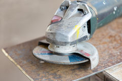 Angle grinder tool on metal sheet Royalty Free Stock Image
