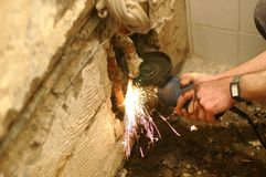 Angle grinder in use. Angle grinder , reconstruction of home concept , plumbing concept Royalty Free Stock Photo