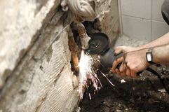 Angle Grinder in use. Angle grinder , reconstruction of home concept , plumbing concept Royalty Free Stock Images