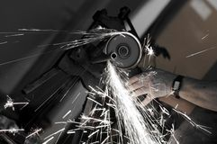 Angle grinder in use. Angle grinder , reconstruction of home concept , plumbing concept Stock Image