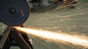 Angle grinder, which cuts the tube plate, fixed to the metal corner. Power The work done in the workshop at the factory. The object is firmly fixed. When stock video
