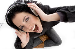 angle headphone high holding smiling view woman Στοκ Εικόνα